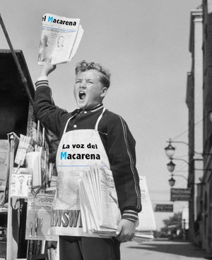 circa 1945: Full-length image of a newsboy shouting beside a newsstand while holding a newspaper in the air and a bundle of 'The Evening Bulletin' newspapers under his arm, 1940s. He wears a 'Newsweek' apron. (Photo by Harold M. Lambert/Lambert/Getty Images)